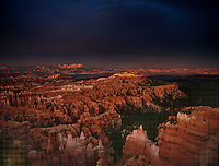 730750053 evening light casts a warm glow on the silent city hoodoos in a clearing monsoon summer storm seen from sunset point at bryce canyon national park utah