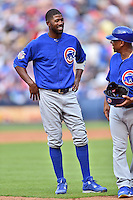 Chicago Cubs center fielder Dexter Fielder (24) talks with third base coach Gary Jones (1) during a game against the Atlanta Braves at Turner Field on June 11, 2016 in Atlanta, Georgia. The Cubs defeated the Braves 8-2. (Tony Farlow/Four Seam Images)