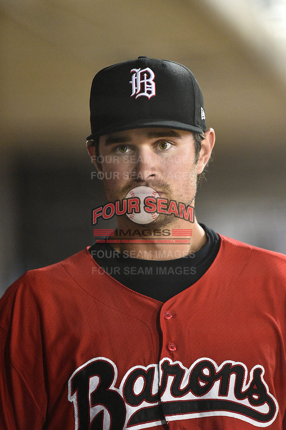 Birmingham Barons third baseman Jeremy Farrell (17) in the dugout during a game against the Tennessee Smokies on April 22, 2014 at Regions Field in Birmingham, Alabama.  Birmingham defeated Tennessee 14-3.  (Mike Janes/Four Seam Images)