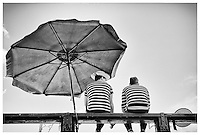 Two gondoliers sitting on Accademia Bridge, Venice, Italy.