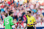 Referee Mario Melero lopez shows a yellow card for Salvatore Sirigu goalkeeper of Osasuna (L) during the La Liga match between Atletico de Madrid vs Osasuna at Estadio Vicente Calderon on 15 April 2017 in Madrid, Spain. Photo by Diego Gonzalez Souto / Power Sport Images