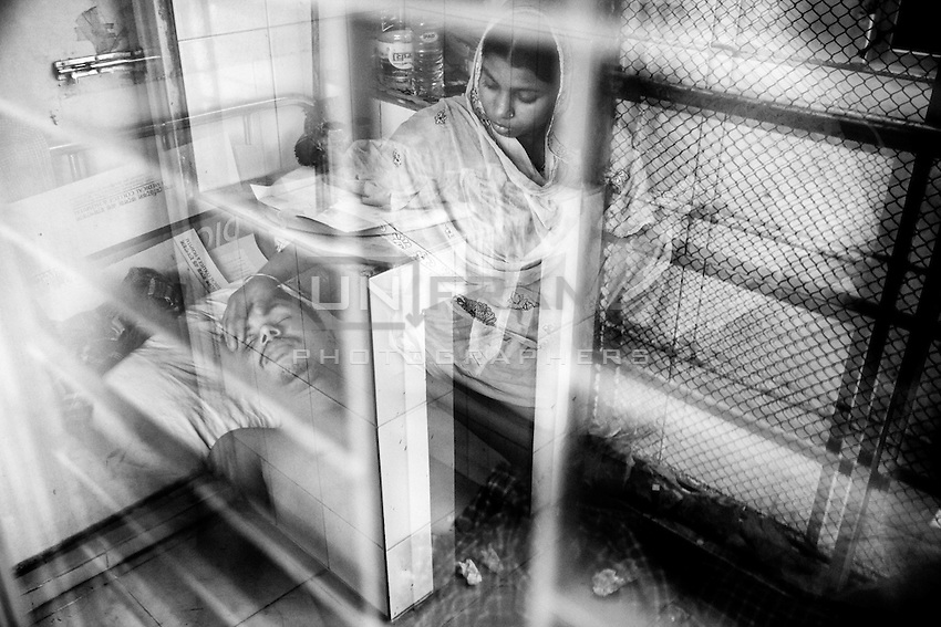 A victim of collapsed build Rana plaza takes treatment at Anam medical college hospital in savar, near Dhaka, Bangladesh