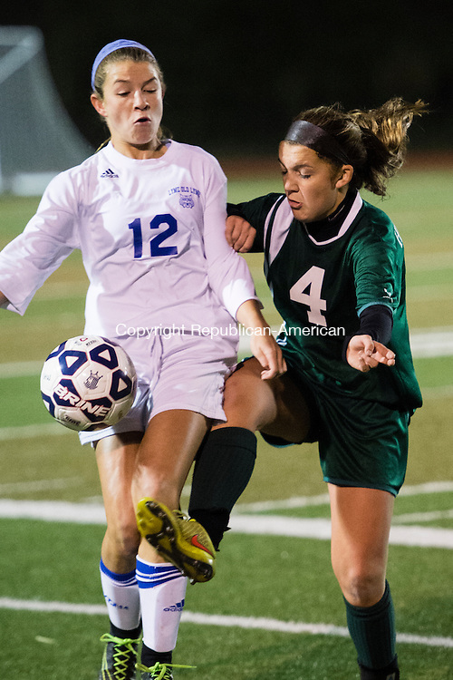 MIDDLETOWN, CT - 16 November 2015-111615EC04-- Holy Cross' Julia Sheetz and Old Lyme's Mya Johnson battle for the ball in Middletown Monday night. Erin Covey Republican-American.