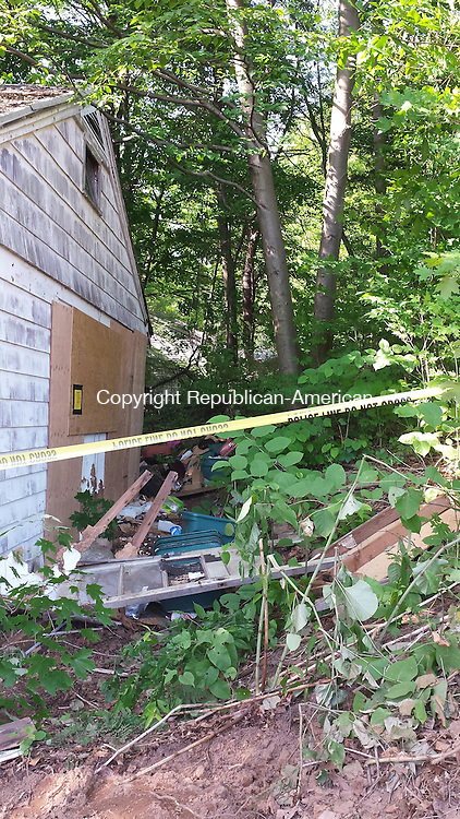 CHESHIRE, CT - June 15, 2014 - 06152014LX03 - A woman who lived in this home on Winslow Street may have died when the floor of her kitchen collapsed.