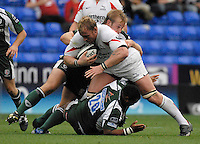 """Reading, GREAT BRITAIN,  Falocns' Andy PERRY""""S run is halted by Richard THORPE standing and Steffon ARMITAGE, during the Guinness Premiership match London Irish vs Newcastle Falcons, at Madejski. England, Sun. 23.09.2007  [Mandatory Credit, Peter Spurrier/Intersport-images]....."""