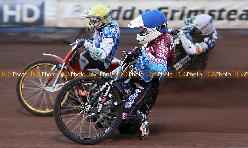 Heat 1: Stuart Robson (blue), Ricky Kling (yellow) and Chris Holder (white) - Lakeside Hammers v Poole Pirates, Elite League Speedway at the Arena Essex Raceway, Pufleet - 04/05/12 - MANDATORY CREDIT: Rob Newell/TGSPHOTO - Self billing applies where appropriate - 0845 094 6026 - contact@tgsphoto.co.uk - NO UNPAID USE..