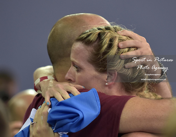 Eilidh Childs (SCO) gets a cuddle after the Womens 400m hurdles final. Athletics. PHOTO: Mandatory by-line: Garry Bowden/SIPPA/Pinnacle - Tel: +44(0)1363 881025 - Mobile:0797 1270 681 - VAT Reg No: 183700120 - 310714 - Glasgow 2014 Commonwealth Games - Hampden Park, Glasgow, Scotland, UK