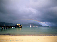 Summer rainbow over Hanalei pier