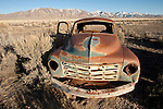 Rusted and abandoned pickup trucks in a field along the highway in Lander County, Nev.