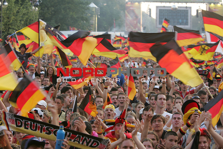 FIFA WM 2006 - Feature Fanmeile Berlin<br /> Play #63 (08-Jul) - Germany vs Portugal.<br /> Supporters from Germany celebrate prior to the match Germany against Portugal at Brandenburger Tor in Berlin.<br /> Foto &copy; nordphoto