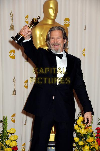 JEFF BRIDGES .82nd Annual Academy Awards held at the Kodak Theatre, Hollywood, California, USA..March 7th, 2010.oscars half length black tuxedo bow tie goatee facial hair award trophy winner arm in air .CAP/ADM/BP.©Byron Purvis/AdMedia/Capital Pictures.