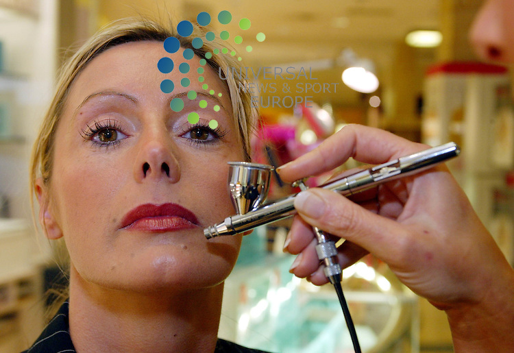 Maurice McDonald.    Frasers Vital Make-Up ..Estee Lauder make-up air brush being used on a customer at Frasers in Glasgow..Vital Feature.....