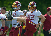 Washington Redskins tight end Michael Cooper (40) and tight end Logan Paulsen (82) participate in warm-up drills during an organized team activity (OTA) at Redskins Park in Ashburn, Virginia on Wednesday, May 25, 2015.<br /> Credit: Ron Sachs / CNP