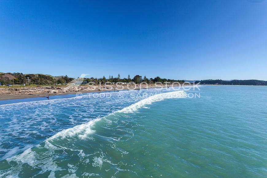 Waves at Tolaga Bay beach from the wharf. Eastland North Island New Zealand.