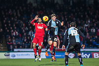 Jason McCarthy of Wycombe Wanderers & Jobi McAnuff of Leyton Orient go for the ball during the Sky Bet League 2 match between Wycombe Wanderers and Leyton Orient at Adams Park, High Wycombe, England on 23 January 2016. Photo by Andy Rowland / PRiME Media Images.