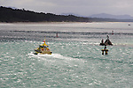 Pilot boat at Tauranga Harbour entrance. The tidal rip passing Stony Point and the statue of Tangaroa is evident.