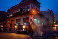 HAVANA, CUBA - JUNE 14: Cubans wait to catch local taxis in Old Havana, Habana Vieja, on June 15, 2015 in Havana, Cuba. <br /> Daniel Berehulak for Panasonic/Lumix