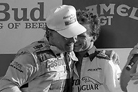Price Cobb , left, talks with Jan Lammers in victory lane after driving his Castrol Racing Jaguar XJR-10 to victory in the IMSA GTP/Lights race at the Florida State Fairgrounds in Tampa, FL, October 1, 1989.  (Photo by Brian Cleary/www.bcpix.com)