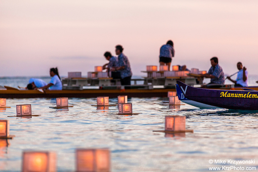 Volunteers on boat placing candles in the water at the 15th annual lantern floating ceremony at Ala Moana Beach Park  on Memorial Day