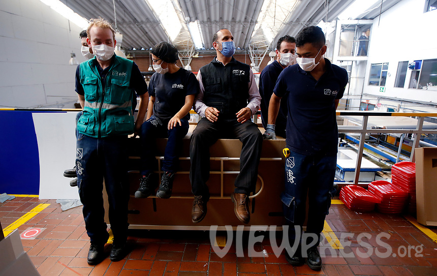 BOGOTA, COLOMBIA - MAY 14: Workers sit on a hospital bed which in case to be needed can be used as a coffin in Bogota, May 14, 2020. The bed was designed by a Colombian company for COVID-19 patients amid the new coronavirus pandemic that infected 12.930 people and claimed 509 lives in the country. (Photo by Leonardo Munoz/VIEWpress)