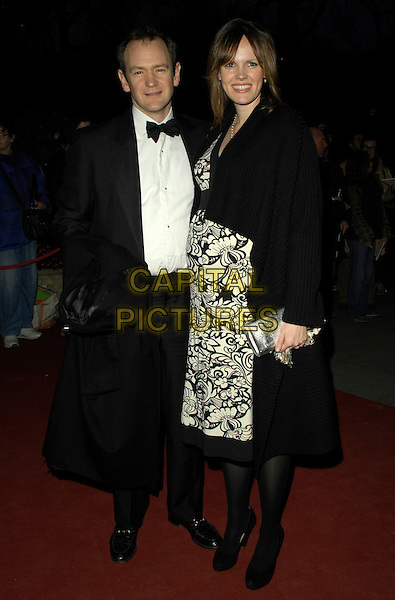 ALEXANDER ARMSTRONG & WIFE.Arrivals - Laurence Olivier Awards at the Grosvenor Hotel, Park Lane, London, UK..February 18th, 2007.full length black tuxedo dress pattern.CAP/CAN.©Can Nguyen/Capital Pictures
