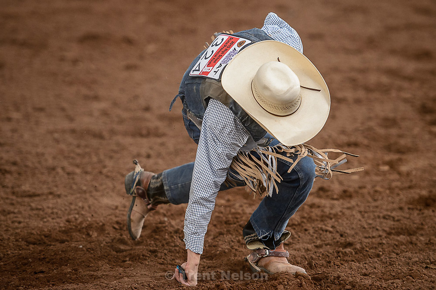 Trent Nelson  |  The Salt Lake Tribune<br /> Nathan Urie gets up after competing in Saddle Bronc at the Utah High School Rodeo Association state championships in Heber, Saturday June 6, 2015.