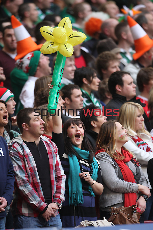 A proud Welsh fan sings the anthem..RBS 6 Nations 2011.Wales v Ireland.Millennium Stadium.12.03.11.Photo Credit: Steve Pope - Sportingwales
