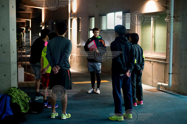 Sports trainer Reia Chinen, 30, with his students in the Koza Sports Park. <br /> He has no memory of his father, a US serviceman who split from his mother when he was still a baby, and doesn't speak English at all. He is one of the many 'haafu' (from the English 'half') in Okinawa, a consequence of the US military presence on the island.
