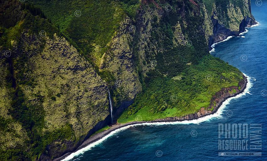 An aerial view of a waterfall along the Hamakua coastline north of Waipi'o Valley, Big Island.