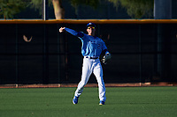 AZL Royals left fielder Darryl Collins (21) throws a ball to the infield during an Arizona League game against the AZL Brewers Blue at Surprise Stadium on June 18, 2019 in Surprise, Arizona. AZL Royals defeated AZL Brewers Blue 12-7. (Zachary Lucy/Four Seam Images)