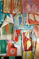 Detail of hand-painted swatches on the wall of artist Caroline Ede's studio