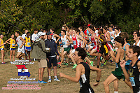 Runners in the Varsity Boys race take off after the gun while Big River Running Race Management's Matt Helbig holds a timing box and looks on at the oncoming rush at the Parkway West Cross Country Invitational.