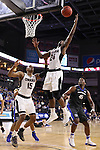 SIOUX FALLS, SD: MARCH 5: 	Tra-Deon Hollins #24 of Omaha grabs a rebound  in front of teammate 	Tre'Shawn Thurman #15 and Brent Calhoun #45 of IPFW during the Summit League Basketball Championship on March 5, 2017 at the Denny Sanford Premier Center in Sioux Falls, SD. (Photo by Dick Carlson/Inertia)
