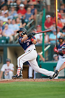 Rochester Red Wings third baseman Jordan Pacheco (9) follows through on a swing during a game against the Pawtucket Red Sox on July 4, 2018 at Frontier Field in Rochester, New York.  Pawtucket defeated Rochester 6-5.  (Mike Janes/Four Seam Images)