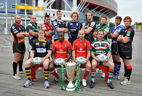 27.09.2010. Heineken Cup UK Launch at  Millennium Stadium, Cardiff, Wales. Players representing competing teams pose for a group photo infront of the Millennium Stadium, Cardiff..(Rear L-R) Tom Willis of Newport Gwent Dragons, Clarke Dermody of London Irish, Matthew Rees of Scarlets, Al Kellock of Glasgow Warriors, Paul Tito of Cardiff Blues, Alun Wyn Jones of Ospreys, Dylan Hartley of Northampton Saints, Luke Watson of Bath Rugby and Roddy Grant of Edinburgh..(Front L-R) Tom Rees of London Wasps, Yves Donguy and Fredric Michalak of Toulouse and Geordan Murphy of Leicester Tigers..