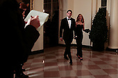 United States Representative Paul Ryan (Republican of Wisconsin), left, and Janna Ryan arrive to a state dinner hosted by U.S. President Barack Obama and U.S. First Lady Michelle Obama in honor of French President Francois Hollande at the White House in Washington, D.C., U.S., on Tuesday, Feb. 11, 2014. Obama and Hollande said the U.S. and France are embarking on a new, elevated level of cooperation as they confront global security threats in Syria and Iran, deal with climate change and expand economic cooperation. <br /> Credit: Andrew Harrer / Pool via CNP