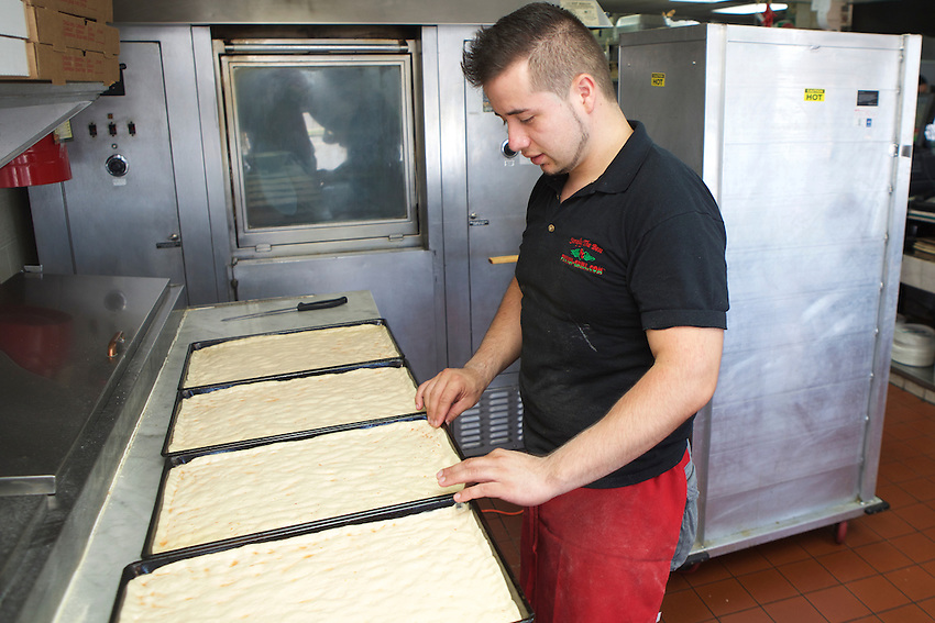 Hamilton, NJ - July 17, 2016: Luigi Severo, head pizza maker at Pizza Grill, home of the Corleone Style Pizza, a square pie made on a focaccia-like crust.<br /> <br /> CREDIT: Clay Williams for Edible Jersey.<br /> <br /> &copy; Clay Williams / claywilliamsphoto.com