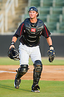 Kannapolis Intimidators catcher Michael Marjama (23) tracks a foul pop fly during the South Atlantic League game against the West Virginia Power at CMC-Northeast Stadium on August 17, 2012 in Kannapolis, North Carolina.  (Brian Westerholt/Four Seam Images)