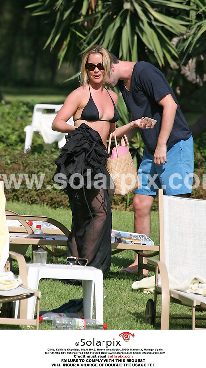 ALL ROUND EXCLUSIVE PICTURES BY SOLARPIX.COM..**MUST CREDIT SOLARPIX.COM OR DOUBLE FEE INCURRED**.Girl Band The Sugarbabes relaxing under the Spanish sun at their Hotel on the afternoon before their concert in Marbella Spain during their European tour...Band member Heidi & TV Presenter boyfriend Dave Berry.This Pic shows:Band member Heidi.Job Ref.AB1 2708 12.8.06