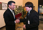 Nevada Gov. Brian Sandoval congratulates graduate Keith Calhoun at a ceremony recognizing the new Starbucks Inclusion Academy at the Starbucks Carson Valley Roasting Plant &amp; Distributions Center in Minden, Nev., on Thursday, Jan. 29, 2015. The program, created by Starbucks and Nevada's Department of Employment, Training and Rehabilitation helps people with disabilities gain work skills and experience. <br />