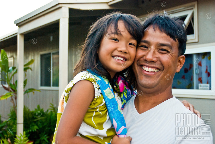 Local dad and daughter in front of home in Makakilo, Oahu
