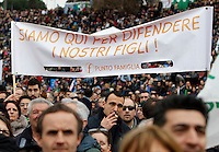 "Manifestazione ""Family Day"" al Circo Massimo, in sostegno della famiglia tradizionale, contro la legge sulle unioni civili in discussione al Senato, Roma, 30 gennaio 2016.<br /> Demonstrators crowd the Circus Maximus during the ""Family Day"" rally in support of traditional family, against civil unions proposed law in discussion at the Italian Parliament, Rome, 30 January 2016. The banner reads ""We are here to defend our children"".<br /> UPDATE IMAGES PRESS/Riccardo De Luca"