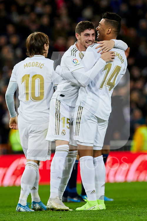 Fede Valverde (L) and Carlos Henrique Casimiro (R) of Real Madrid celebrate goal during La Liga match between Real Madrid and Real Sociedad at Santiago Bernabeu Stadium in Madrid, Spain. November 23, 2019. (ALTERPHOTOS/A. Perez Meca)