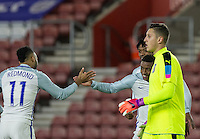 Celebrations as Demarai Gray (centre) (Leicester City) of England scores the opening goal while Goalkeeper Pierluigi Gollini (Aston Villa) of Italy walks past during the Under 21 International Friendly match between England and Italy at St Mary's Stadium, Southampton, England on 10 November 2016. Photo by Andy Rowland.