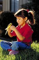 Hispanic girl with pet Budgie. Fresno, California.