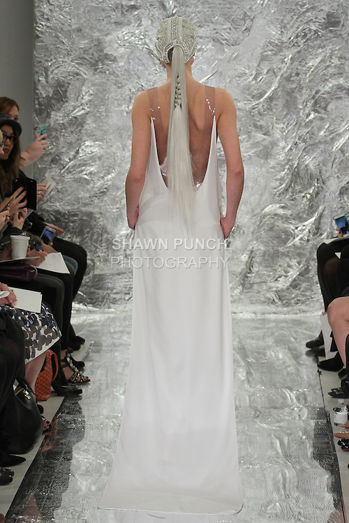 Model Aida Aniulyte walks runway in Jyn - a white silk crepe and vinyl tunic with crystal 3D flowers over pant, from the Theia Spring 2017 bridal collection by Don O'Neill, during New York Bridal Fashion Week Spring Summer 2017 on April 14, 2016.