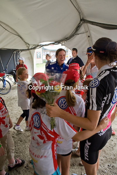 An excited Mary Mcconneloug signs autographs for young fans as Lea Davison,(in foreground), is embraced by young admirers during the awards ceremony for the USAC MBT Mountian Bike Championships at Mount Snow in Dover Vermont.