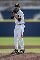 Michigan Wolverines pitcher Isaiah Paige (25) looks to his catcher for the sign against the San Jose State Spartans on March 27, 2019 in Game 1 of the NCAA baseball doubleheader at Ray Fisher Stadium in Ann Arbor, Michigan. Michigan defeated San Jose State 1-0. (Andrew Woolley/Four Seam Images)