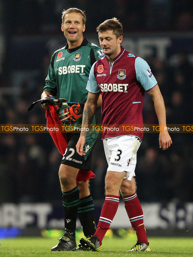 Jussi Jaaskelainen and George McCartney of West Ham look happy with the result at the end of the game - West Ham United vs Manchester City, Barclays Premier League at Upton Park, West Ham - 03/11/12 - MANDATORY CREDIT: Rob Newell/TGSPHOTO - Self billing applies where appropriate - 0845 094 6026 - contact@tgsphoto.co.uk - NO UNPAID USE.