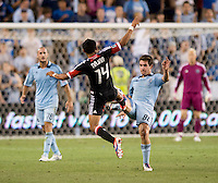 Andy Najar (14) of D.C. United fights for the ball with Michael Thomas (88) of Sporting Kansas City during the game at Livestrong Sporting Park in Kansas City, Kansas.  D.C. United lost to Sporting Kansas City, 1-0.